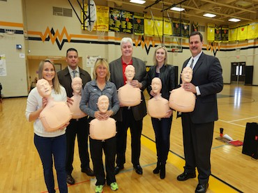 Fifteen CPR Hands Only training kits donated to school district